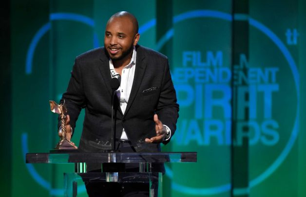 "Justin Simien accepts the award for best first screenplay for ""Dear White People"" at the 30th Film Independent Spirit Awards"