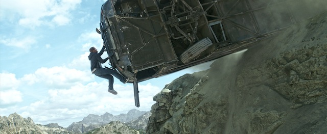 Brian (PAUL WALKER) scales machine and mountain in Furious 7 - Photo Credit- Universal Pictures