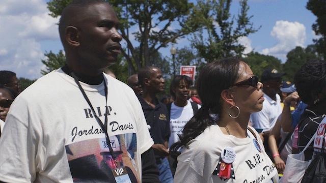 Jordan's parents Ron Davis and Lucia McBath at Rally