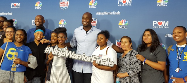 Akbar Gbajabiamila  poses with students from his former high school Crenshaw High
