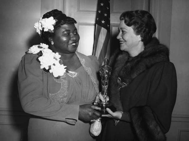 Hattie McDaniel Supporting Actress winner for Gone with the Wind, posing with an Oscar statuette with presenter Fay Bainter