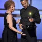 Jesse Williams accepts his award from Debra Lee