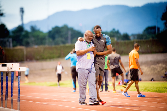 Bolt with his coach Glen