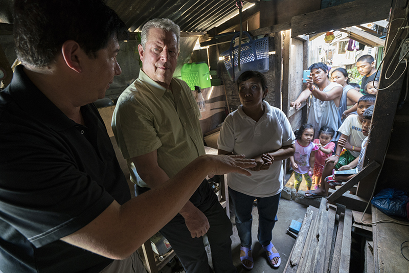 VP Al Gore with former Mayor of Tacloban City Alfred Romualdez and Typhoon Haiyan survivor Demi Raya, in the Raya family home; Tacloban City, Philippines - Photo Credits- Jensen Walker