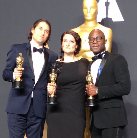 Producers Jeremy Kleiner (L) and Adele Romanski (C), winners of the award for Best Picture for Moonlight with filmmaker Barry Jenkins