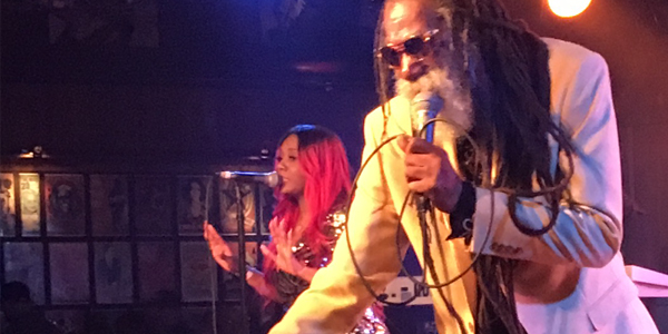 Don Carlos shaking his fans hands during his performance at the Belly UP in San Diego, CA