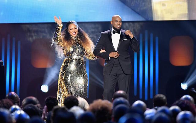 Co-Hosts Erica Campbell and Anthony Brown onstage at the 32nd Annual Stellar Awards