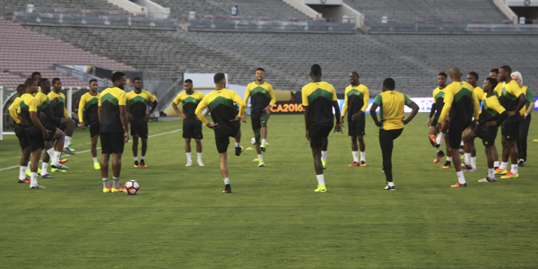 Reggae Boyz warming up for the COPA America last September at the Rose Bowl with past head coach Winfred Schafer. He was fired from the position after exiting the tournament with zero point. Photo by L. Johnson
