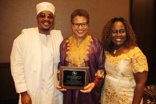 Karen Bass (center) with her Lifetime membership plaque