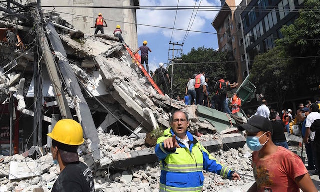 Rescuers search for survivors amid the rubble of a collapsed building after the powerful quake in Mexico City. Photograph- Alfredo Estrella:AFP:Getty Images