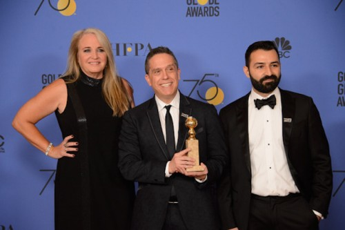Darla K. Anderson, Lee Unkrich, and Adrian Molina pose with the Golden Globe award For BEST ANIMATED FEATURE FILM for Coco