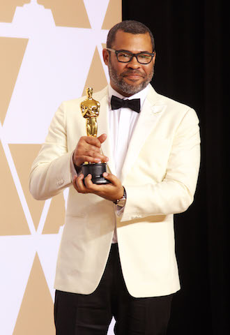 Jordan Peele became the first African American to take original screenplay for the horror film Get Out - Photo by Royalty Images
