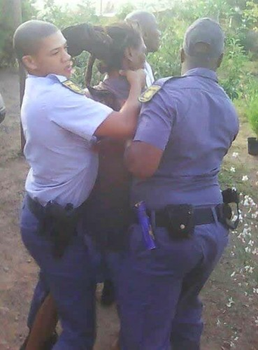 Police arresting a Rastafarian in South Africa (Public domain)