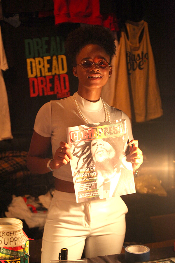 One of Jamaica newest female reggae artist Lila Ike touring and open up for Protoje show posed with a CaribPress in front Protoje's booth inside the Dub club | Photo by Love Zone 2018 ©