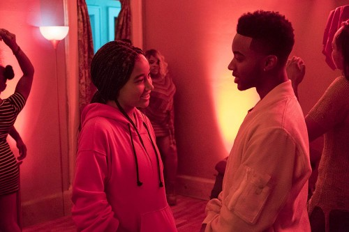 """Starr (Amandla Stenberg) runs into Khalil (Algee Smith), a childhood friend, at a party in """"The Hate U Give"""" (20th Century-Fox)"""