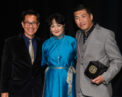 """Arthur Dong and Mart Bira, winner of the gold medal in the foreign documentary film category for """"Nomadic Doctor,"""" during the 45th Annual Student Academy Awards® on Thursday, October 11, in Beverly Hills. (credit: Matt Petit / ©A.M.P.A.S.)"""