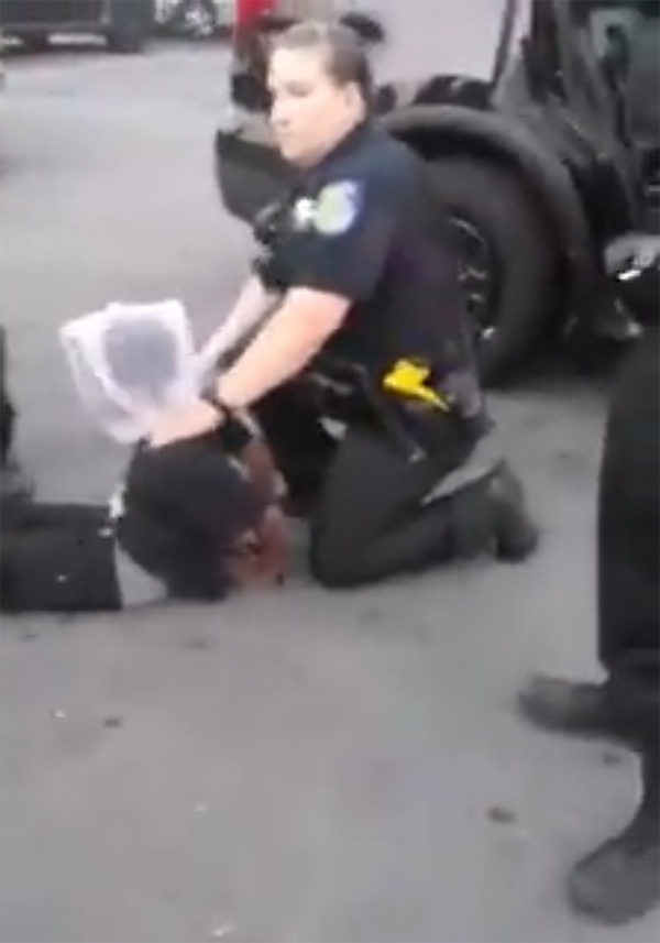 Sacramento PD officer restrains young man from a still shot from the video captured by a bystander that has been seen on the Sacramento Black Lives Matter's Facebook page.