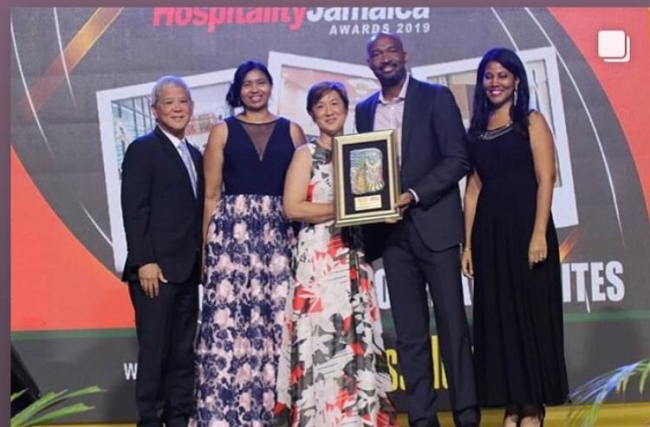 Caption- Courtleigh Hotel and Suites executives receive Jamaica's Best Business Hotel honors at 2019 Hospitality Jamaica Awards.